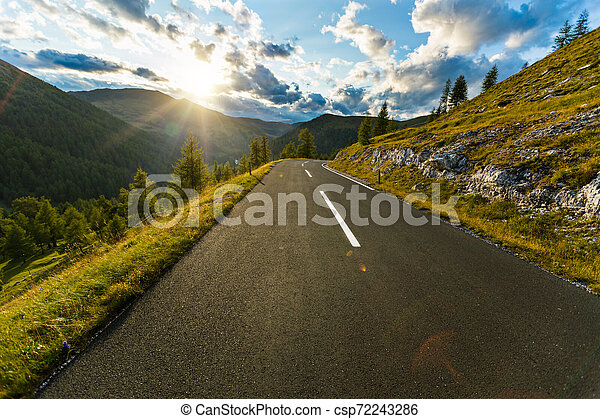 Asphalt road in Austria, Alps in a summer day. - csp72243286