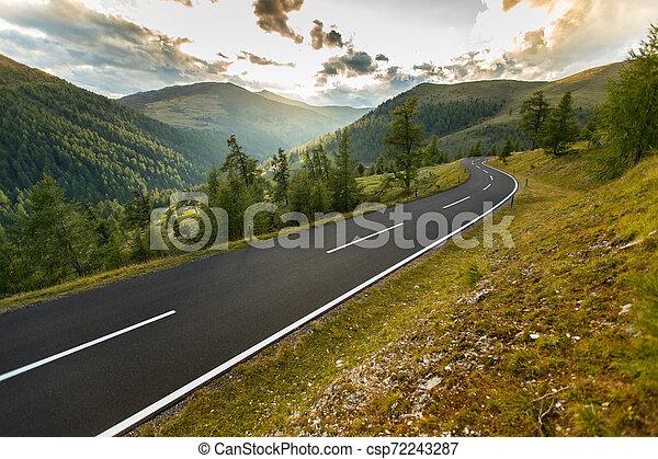 Asphalt road in Austria, Alps in a summer day. - csp72243287