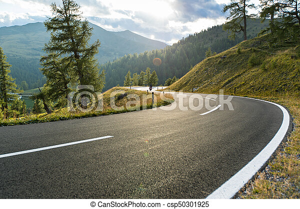 Asphalt road in Austria, Alps in a summer day. - csp50301925