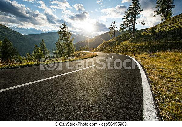 Asphalt road in Austria, Alps in a summer day. - csp56455903
