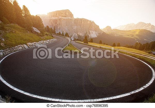 Asphalt road in Dolomites in a summer day. - csp76896395