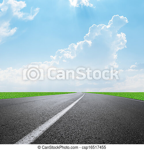 asphalt road to horizon and clouds on sky - csp16517455