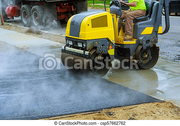 Asphalting construction works with commercial repair equipment road crews - csp57662762