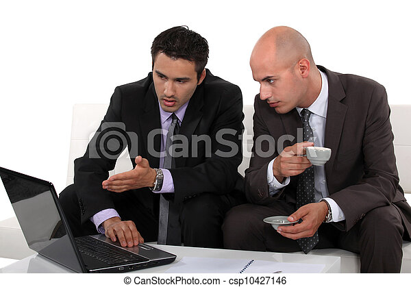 Associates discussing their business plan - csp10427146