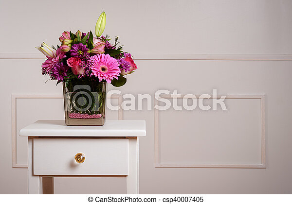 Assorted Flowers In Glass Vase On Table