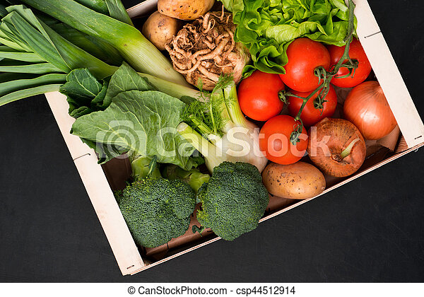 Assorted Fresh Vegetables in a Wooden Box - csp44512914