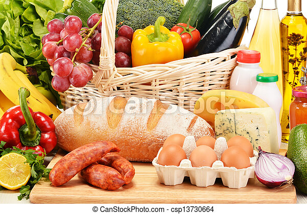 Assorted grocery products including vegetables fruits wine bread dairy and meat - csp13730664