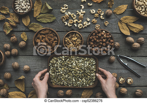 assorted nuts and autumn leaves - csp52386276