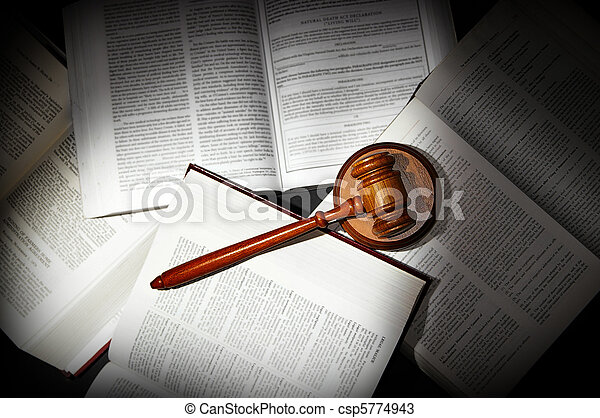 assorted open law books with legal gavel, in dramatic light - csp5774943
