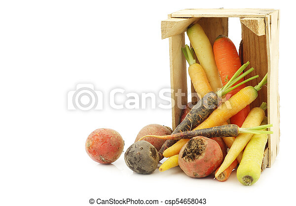 assorted root vegetables in a wooden crate - csp54658043