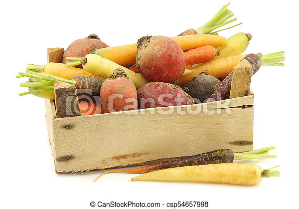 assorted root vegetables in a wooden crate - csp54657998