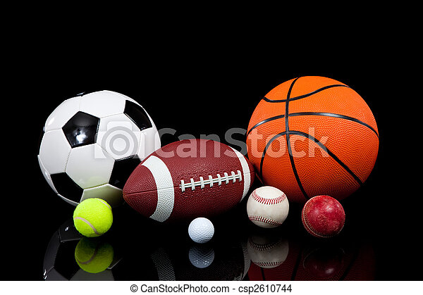 Assorted sports balls on a black background - csp2610744