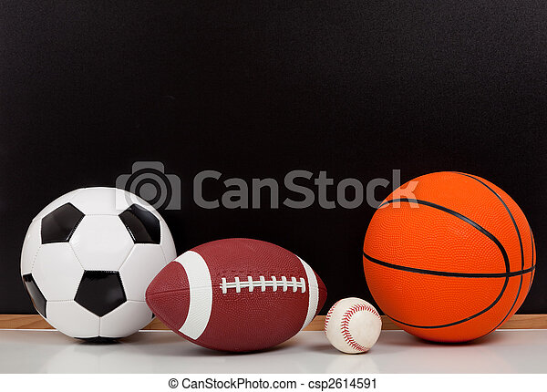 Assorted sports balls with a black chalk board background - csp2614591