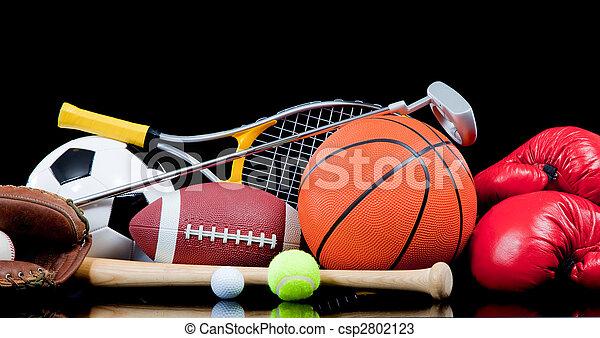 Assorted sports equipment on black - csp2802123