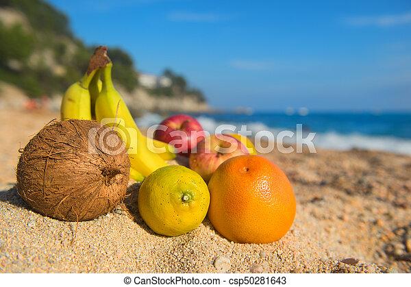 Assortment fruit at the beach - csp50281643