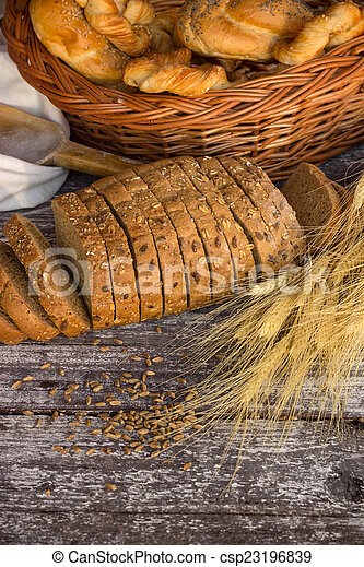 assortment of baked bread - csp23196839