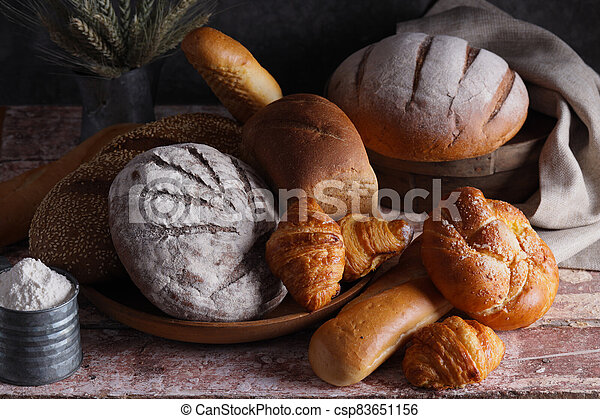 assortment of bakery fresh bread and buns - csp83651156