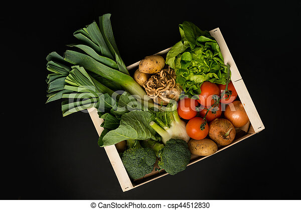 Assortment of Fresh Vegetables in a Wooden Crate - csp44512830
