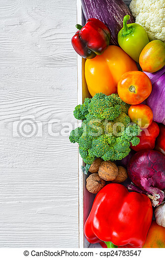 Assortment of fresh vegetables on wooden table - csp24783547