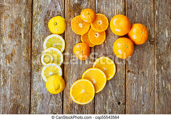 assortment of sliced tropical fruits rustik wood fresh citrus background - csp55543564