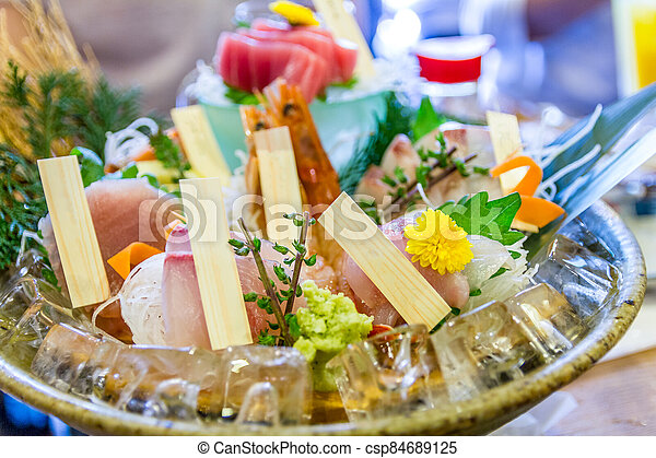 Assortment of sushi and sashimi served on a plate - csp84689125