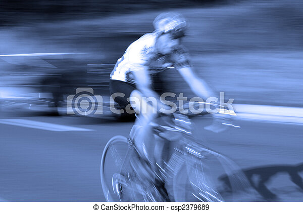 ast bicycle road race cyclist with motion blur - csp2379689
