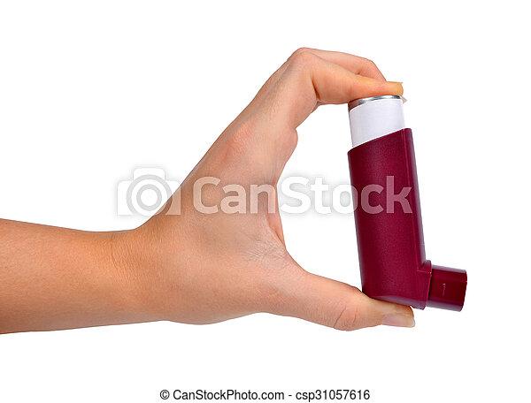 Asthma inhaler in hand  - csp31057616