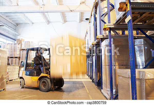 at a warehouse with forklift loader - csp3800759
