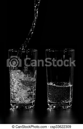at two glass clean water is poured - csp33622309