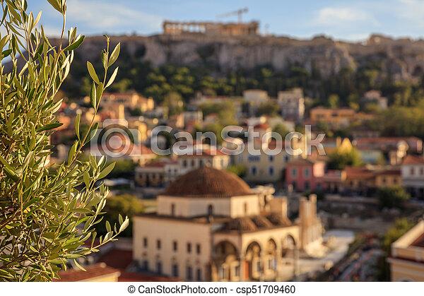 Athens, Greece. Olive tree on Acropolis and Monastiraki abstract background - csp51709460
