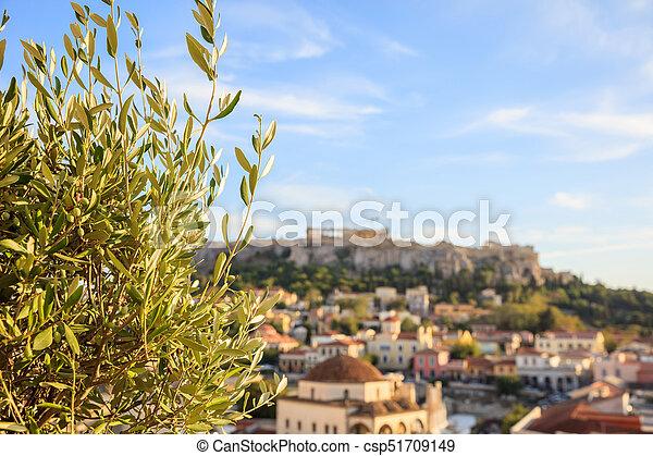 Athens, Greece. Olive tree on Acropolis and Monastiraki abstract background - csp51709149