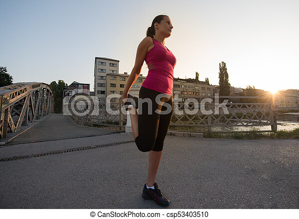 athlete woman warming up and stretching - csp53403510