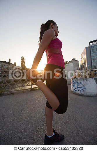 athlete woman warming up and stretching - csp53402328