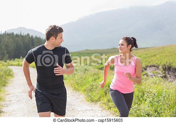 Athletic couple on a jog - csp15915603