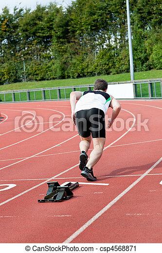 Athletic man running in a stadium - csp4568871