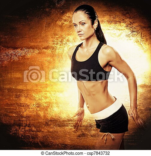 Athletic woman on golden background. - csp7843732