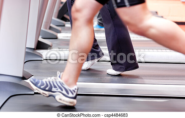 Athletic woman running on a running - csp4484683