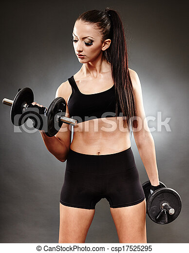 Athletic woman working out with dumbbells - csp17525295