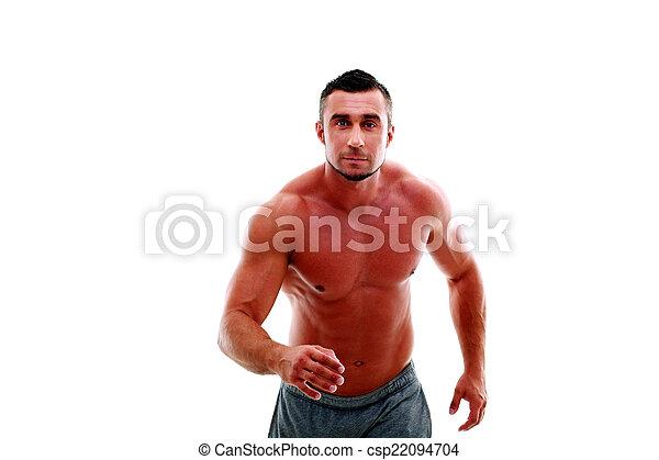 Retrato de atleta musculoso haciendo ejercicio - csp22094704