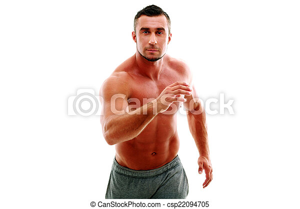 Retrato de atleta musculoso haciendo ejercicio - csp22094705