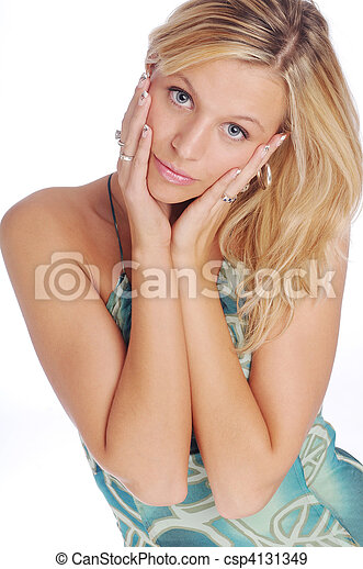 Atractive blonde woman in blue patterned dress on the white background - csp4131349