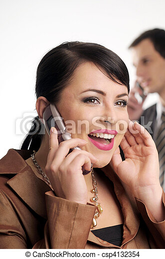 Atractive brunette woman with mobile phone - csp4132354