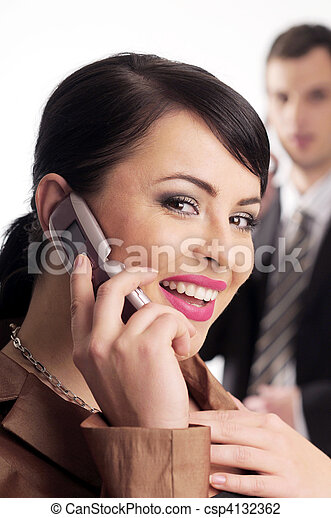 Atractive brunette woman with mobile phone - csp4132362