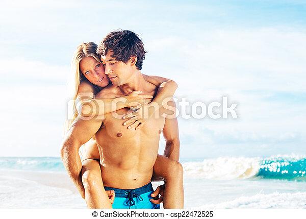 Atractive Couple Having Fun on the Beach - csp22472525