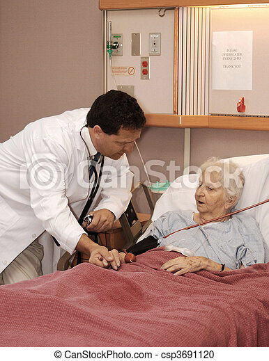 attending to senior woman in hospice - csp3691120
