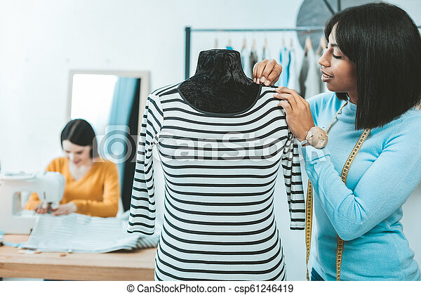 Attentive Fashion Designer Making Dress My Business Cheerful Female Person Standing In Semi Position While Measuring