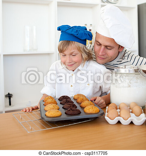 Attentive father and his son presenting their muffins - csp3117705