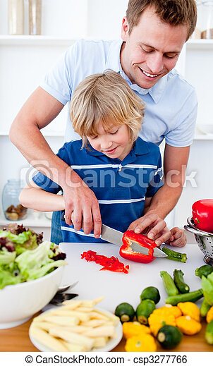 Attentive father preparing dinner with his son in the kitchen - csp3277766