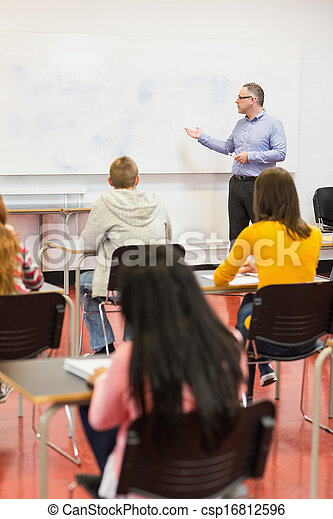 Attentive students with teacher in the classroom - csp16812596