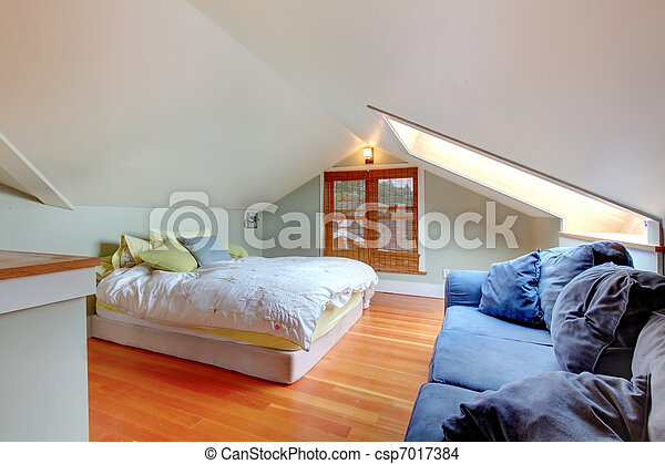 Attic Bedroom With Low Ceiling And Green Walls Stock Photo